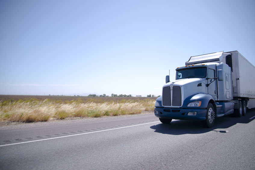 Big rig semi truck with stainless steel spoiler and reefer trail